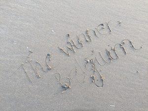 Schrift im Sand